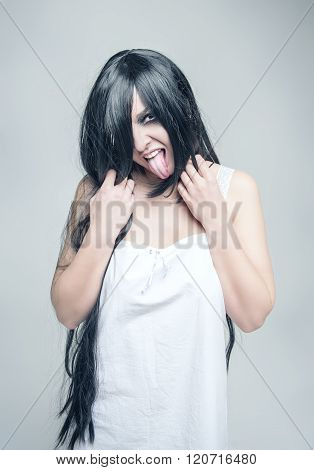 Mystical Crazy Woman Showing Tongue