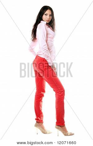 Pretty Brunette In Red Jeans