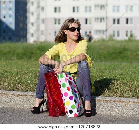 Happy Woman Sitting On Border