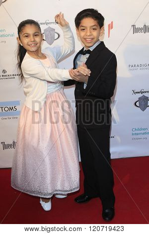 MALIBU - MAR 5: Kevin Tellez, Gaby Palacio at the Children International Charity's 'Share The Love Around The World' Fundraiser at Rocky Oaks Malibu on March 5, 2016 in Malibu, California