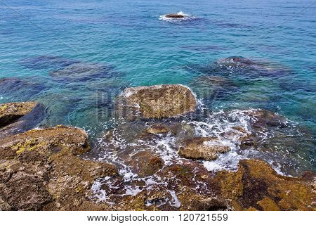 Clear Blue Sea With Rocky Shore
