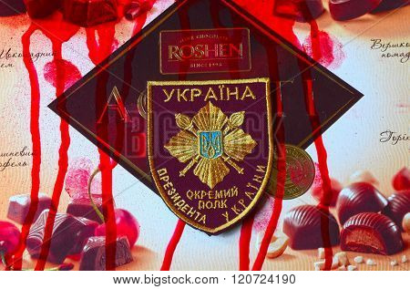 ILLUSTRATIVE EDITORIAL.Chevron of Ukrainian nazionalist battalion. With logo Roshen Inc. Trademark Roshen is property of Ukrainian president Poroshenko.At February 20,2016 in Kiev, Ukraine