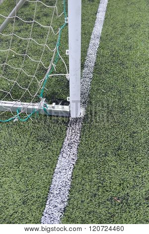 Detail Of A Used And Scratched Gate Of Football At A Soccer Field Made From Green Rubber