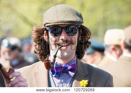 Young Man In Vintage Clothes, Sunglasses And A Smoking Pipe