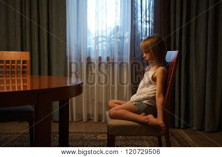 Offended Girl Sitting On A Chair