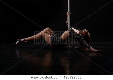 Erotica and dance. Sexy dancer posing with pylon