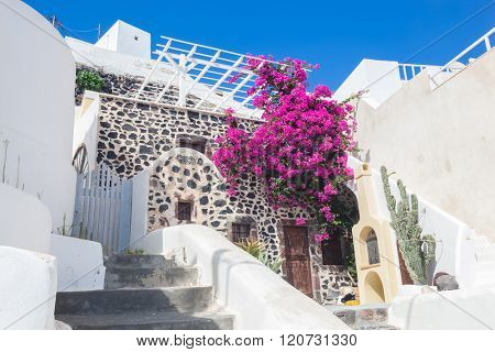 Traditional Greek whitewashed stone house, Santorini island, Greece. Characteristic, picturesque architecture