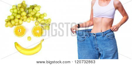 Slimming woman wearing big pants over white background.