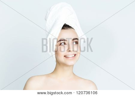 beautiful woman with white towel on his head