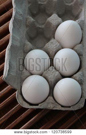 Five Eggs in a Carton