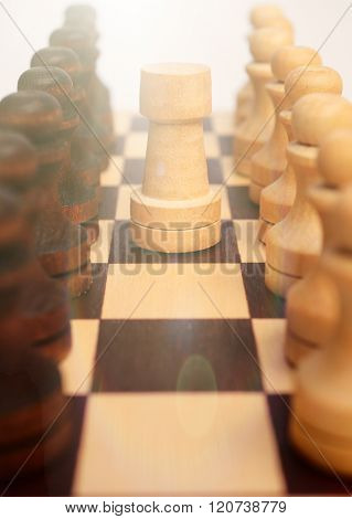 Troop pawns and Rook on chessboard.