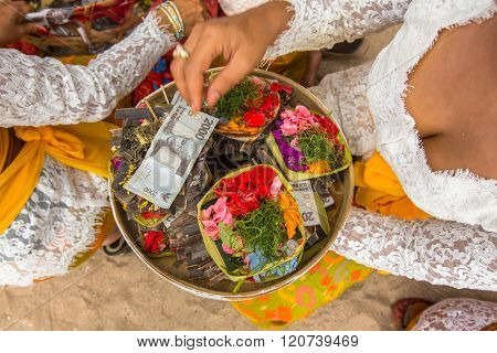 SANUR, BALI - MAR 18, 2016: Unidentified local people during Melasti Ritual. Melasti is a Hindu Balinese purification ceremony and ritual is held several days prior to the Nyepi holy day.