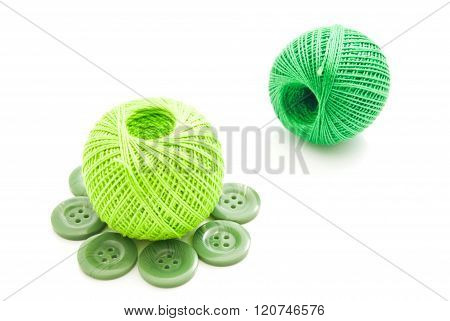 Green Plastic Buttons And Thread