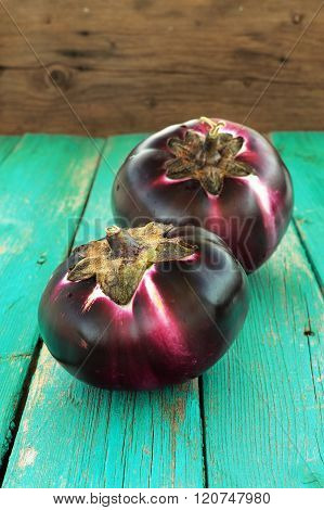 Two Fresh Organic Aubergines On Turquoise Background