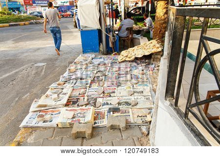 Newspapers And Bread In The Street.