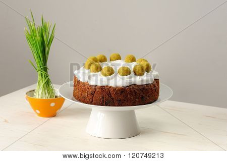 Simnel, Homemade English Easter Cake And Sprouted Green Grass On Minimalistic White Backgrpund