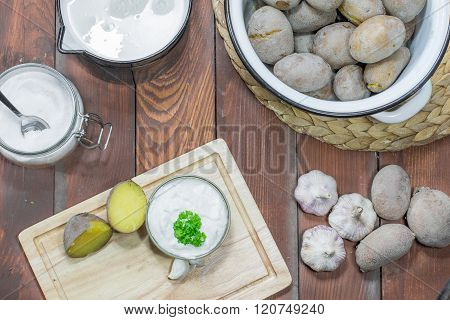 Jacket Potatoes Garlic Dip Milk and Salt on Wooden Board