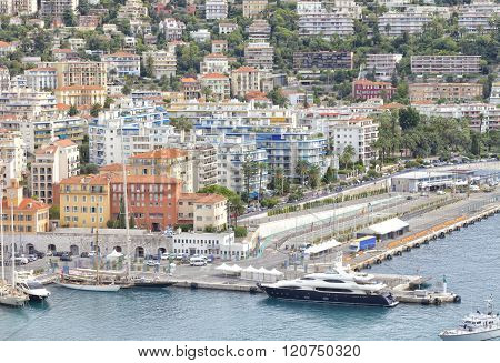 Nice sea bay with super yachts, sail boats, luxury villas and flats