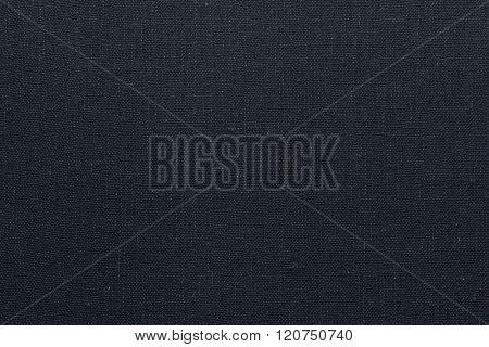 Dark grey canvas texture. Dark grey background.