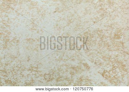 Badly damaged beige cardboard texture. Beige background.
