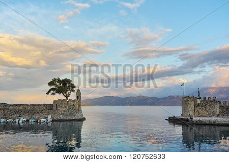 Amazing sunset of the port of Nafpaktos town, Greece