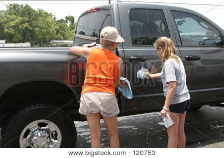 Mom & Daughter Washing Truck