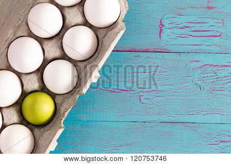 Egg Box Of White Easter Eggs With One Green One