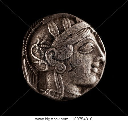 Ancient Greek Silver Coin On A Black Background