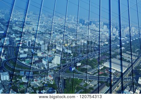 Reflect Of Aerial View Of Cityscape Expressway And Highway On Metal Wall, Blue Tone, Bangkok Thailan