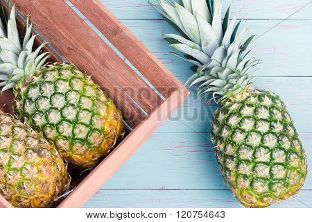 Three Fresh Pineapples, Two In A Wooden Crate