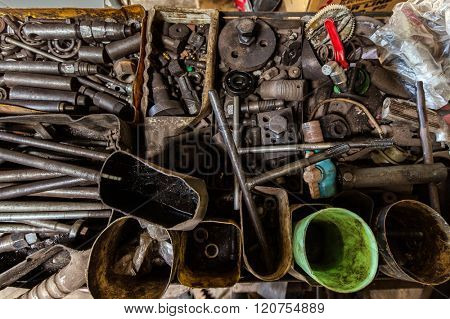 Tools and vehicles parts in a mechanical turner workshop
