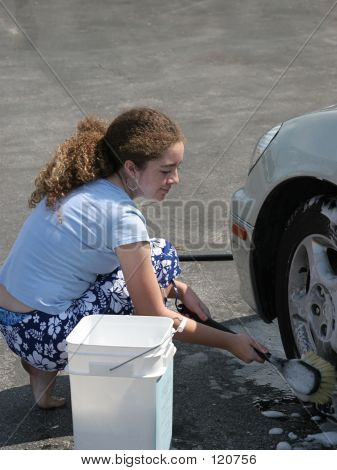 Teen Washing Car