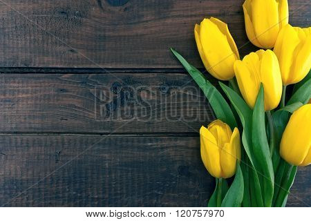 Bouquet Of Yellow Tulips On Dark Rustic Wooden Background. Spring Flowers. Spring Background. Valent
