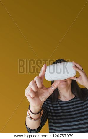 A Woman Touching Something In A 3D Experience With A Vr Headset