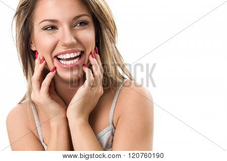 Beautiful young woman laughing and showing her perfect white teeth