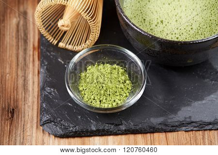 Green Matcha Tea On A Wooden Table