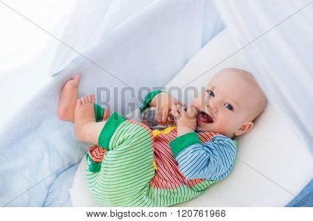 Little Baby With Bottle In White Bed