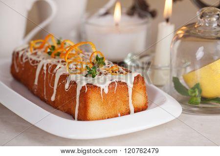 plum-cake white chocolate orange zest thyme close-up still life celebration candles holiday birthday christmas