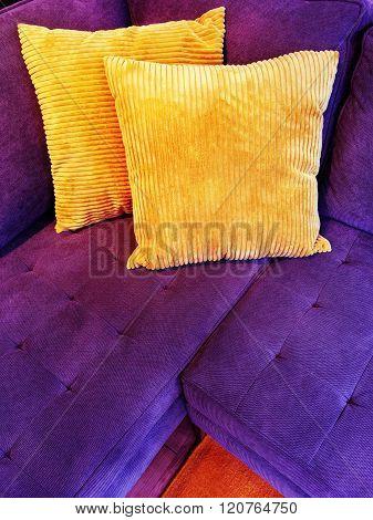 Vibrant Purple Sofa With Orange Cushions