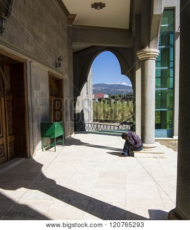 ADDIS ABABA, ETHIOPIA- NOVEMBER 8, 2014: Unidentified man earnestly prays at an Ethiopian Orthodox church in Addis Ababa, Ethiopia.