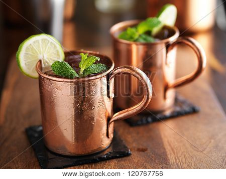 moscow mules in copper cups on slate coasters