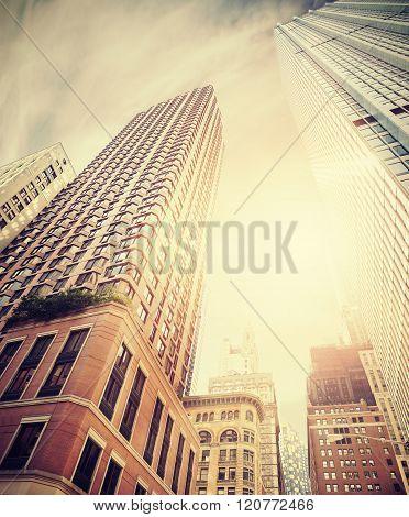 Retro Toned Photo Of Manhattan Buildings Against Sun, Nyc.
