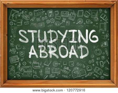 Studying Abroad - Hand Drawn on Green Chalkboard.