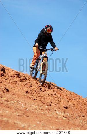 Girl Downhill On Mountain Bike