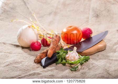 The Crude Vegetables And Knife On A Sacking