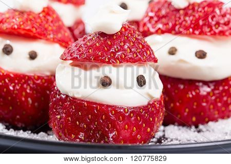 Group Of Santa-klaus From Berries Of Strawberry And Cream