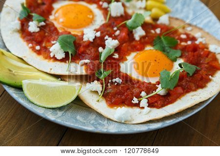 Breakfast with fried egg and sauce on grilled tortilla, Mexicanhuevos rancheros