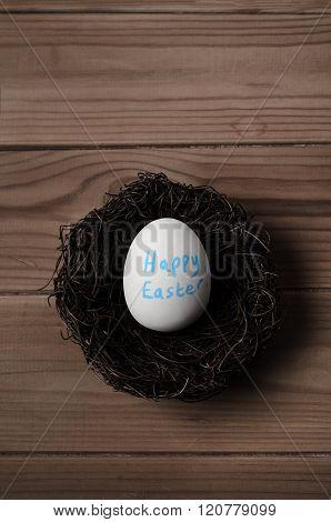 Easter Egg In Nest On Wood Overhead