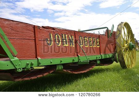 Red and green restored John Deere manure spreader