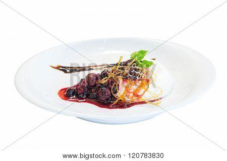 mascarpone with caramel and raspberrys sauce on white background